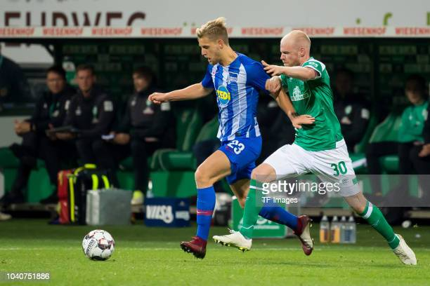 Arne Maier of Hertha BSC and Davy Klaassen of Werder Bremen battle for the ball during the Bundesliga match between SV Werder Bremen and Hertha BSC...
