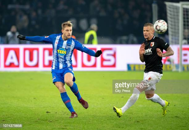 Arne Maier of Hertha BSC and Jonathan Schmid of FC Augsburg during the Bundesliga match between Hertha BSC and FC Augsburg at Olympiastadion on...