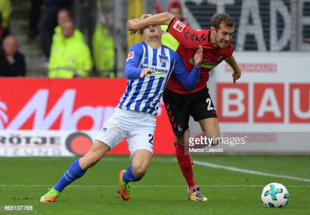 Arne Maier of Hertha BSC and Julian Schuster of SC Freiburg during the game between SC Freiburg and Hertha BSC on October 22 2017 in Freiburg Germany