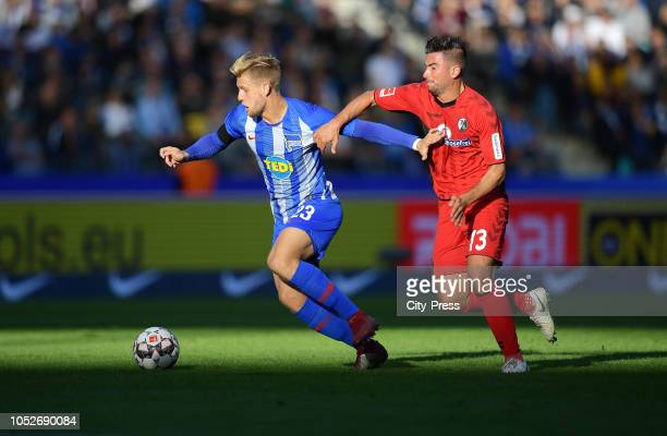 Arne Maier of Hertha BSC and Marco Terrazzino of SC Freiburg during the game between Hertha BSC and SC Freiburg at the Olympiastadion on october 21...