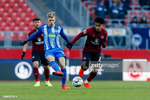 Arne Maier of Hertha BSC and Matheus Pereira of 1 FC Nuernberg battle for the ball during the Bundesliga match between 1 FC Nuernberg and Hertha BSC...