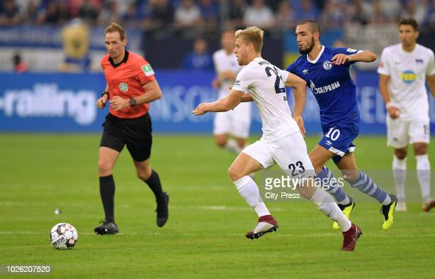 Arne Maier of Hertha BSC and Nabil Bentaleb of FC Schalke 04 during the game between Schalke 04 and Hertha BSC at the Veltins Arena on september 2...