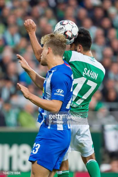 Arne Maier of Hertha BSC and Nuri Sahin of Werder Bremen battle for the ball during the Bundesliga match between SV Werder Bremen and Hertha BSC at...