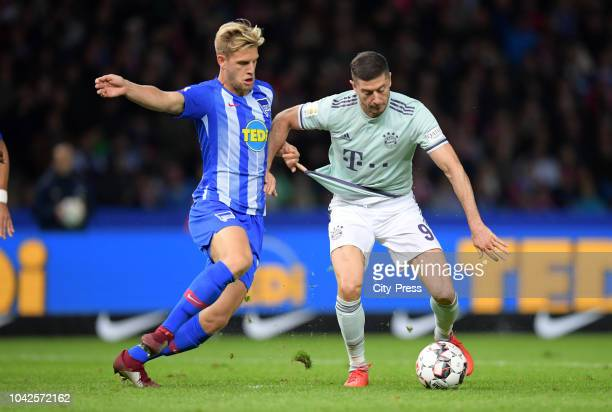 Arne Maier of Hertha BSC and Robert Lewandowski of FC Bayern Muenchen in action during the Bundesliga match between Hertha BSC and Bayern Muenchen at...