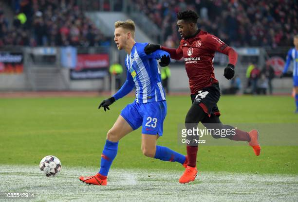Arne Maier of Hertha BSC and Virgil Misidjan of 1 FC Nuernberg during the game between the 1FC Nuernberg and Hertha BSC at the MaxMorlockStadion on...
