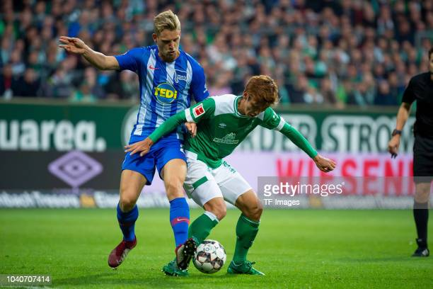 Arne Maier of Hertha BSC and Yuya Osako of Werder Bremen battle for the ball during the Bundesliga match between SV Werder Bremen and Hertha BSC at...