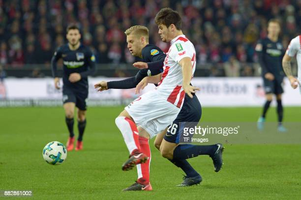 Arne Maier of Hertha BSC Berlin and Jorge Mere of Koeln battle for the ball during the Bundesliga match between 1 FC Koeln and Hertha BSC at...