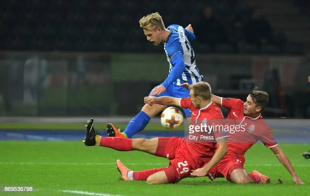Arne Maier of Hertha BSC Dmytro Grechyshkin and Igor Kharatin of FC Zorya Luhansk during the game between Hertha BSC and Zorya Luhansk on november 2...