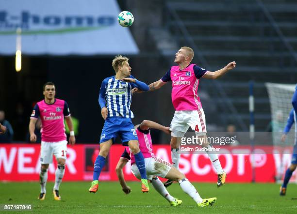 Arne Maier of Hertha BSC fights for the ball with Rick van Drongelen during the Bundesliga match between Hertha BSC and Hamburger SV at...