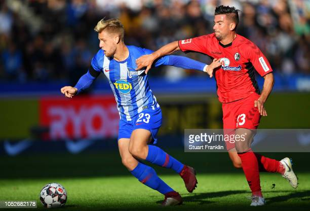 Arne Maier of Hertha BSC holds off Marco Terrazzino of Freiburg during the Bundesliga match between Hertha BSC and SportClub Freiburg at...