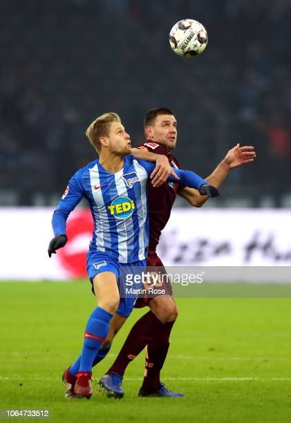 Arne Maier of Hertha BSC is challenged by Adam Szalai of 1899 Hoffenheim during the Bundesliga match between Hertha BSC and TSG 1899 Hoffenheim at...