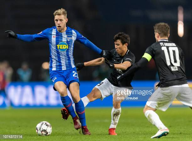 Arne Maier of Hertha BSC is challenged by JaCheol Koo of FC Augsburg during the Bundesliga match between Hertha BSC and FC Augsburg at Olympiastadion...