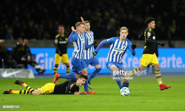 Arne Maier of Hertha BSC is challenged by Julian Weigl of Borussia Dortmund during the Bundesliga match between Hertha BSC and Borussia Dortmund at...
