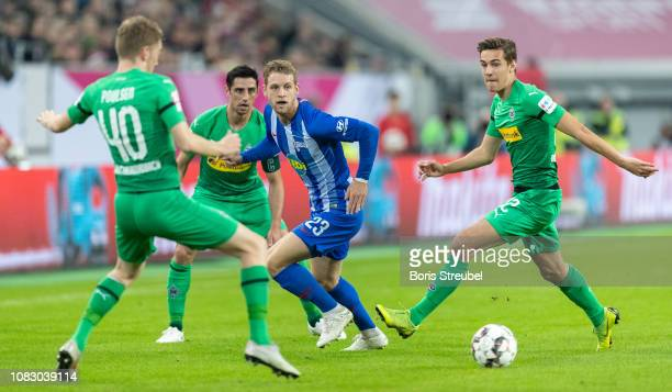 Arne Maier of Hertha BSC is challenged by players of Borussia Moenchengladbach during the Telekom Cup 2019 semifinal match between Borussia...