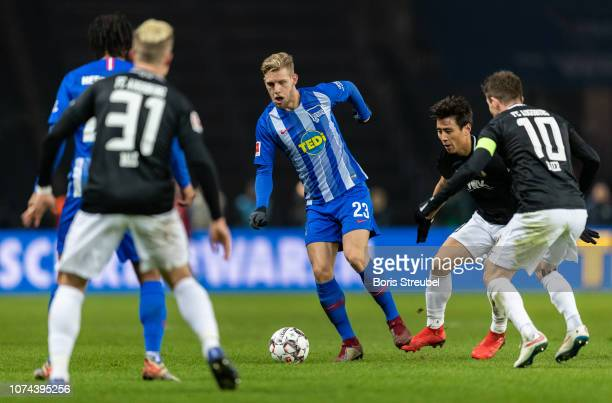 Arne Maier of Hertha BSC is challenged by players of FC Augsburg during the Bundesliga match between Hertha BSC and FC Augsburg at Olympiastadion on...