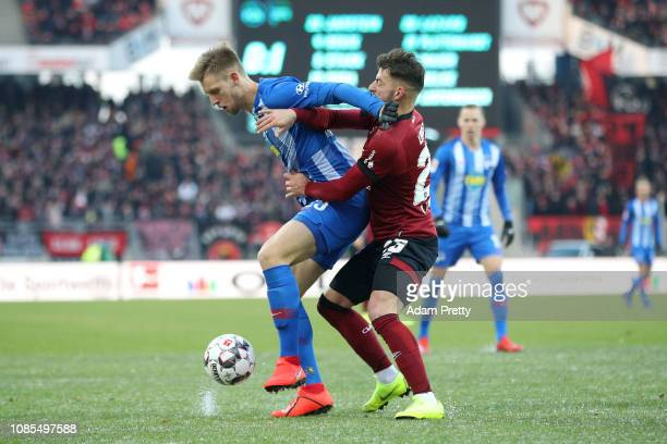 Arne Maier of Hertha BSC is challenged by Tim Leibold of 1 FC Nuernberg during the Bundesliga match between 1 FC Nuernberg and Hertha BSC at...