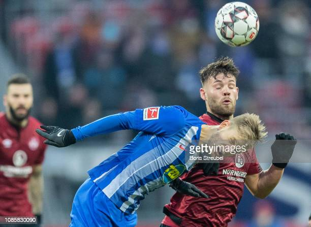 Arne Maier of Hertha BSC jumps for a header with Eduard Loewen of 1 FC Nuernberg during the Bundesliga match between 1 FC Nuernberg and Hertha BSC at...