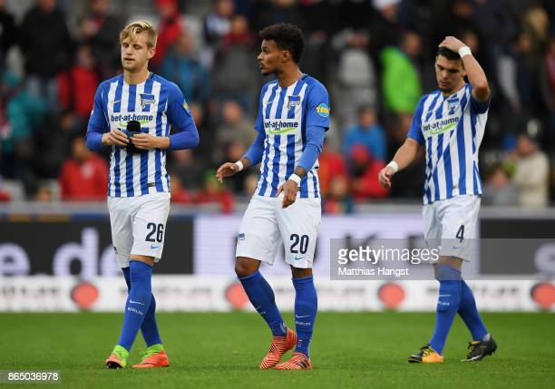 Arne Maier Valentino Lazaro and Karim Rekik of Berlin show their disappointment after the Bundesliga match between SportClub Freiburg and Hertha BSC...