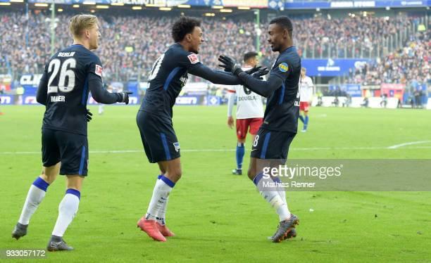 Arne Maier Valentino Lazaro and Salomon Kalou of Hertha BSC celebrate after scoring the 12 during the Bundesliga game between Hamburger SV and Hertha...