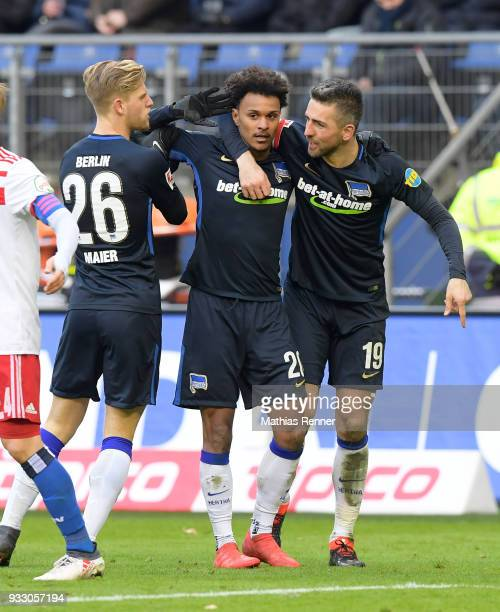 Arne Maier Valentino Lazaro and Vedad Ibisevic of Hertha BSC celebrate after scoring the 11 during the Bundesliga game between Hamburger SV and...