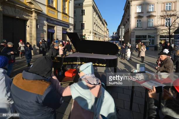 Arne Schmitt a German pianist and a street musician performs in Krakows Main Square At the age of 29 Arne Schmitt gave up his job in a car repair...
