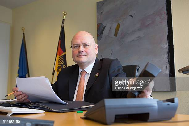Arne Schoenbohm, President of the Federal Office for Security and Information Technology , at his desk.