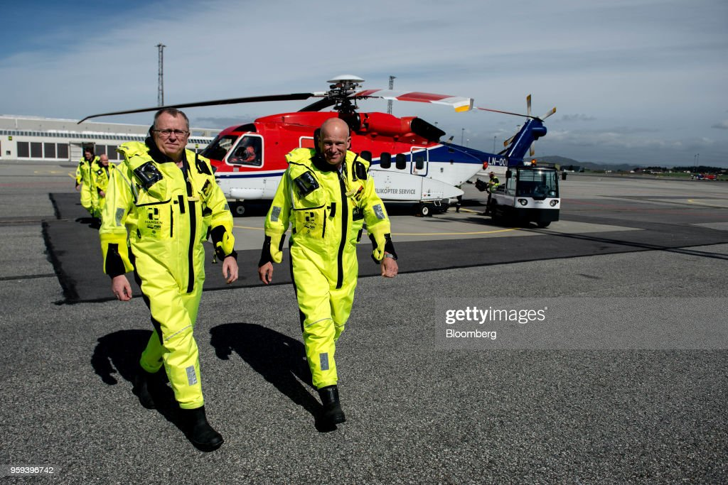 Arne Sigve Nylund, head of development and production in Norway for Equinor ASA, right, and Eldar Saetre, chief executive officer of Equinor ASA, disembark from a helicopter after arriving from the Troll A natural gas platform, operated by Equinor ASA, in Stavanger, Norway, on Wednesday, May 16, 2018. Statoil has changed its name toEquinorto reflect its mutation into a broader energy company.Photographer: Carina Johansen/Bloomberg via Getty Images