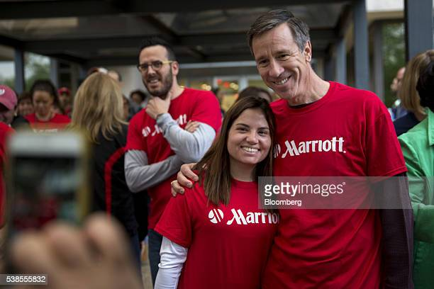 Arne Sorenson president and chief executive officer of Marriott International Inc right has his photo taken with an employee during a Spirit to Serve...