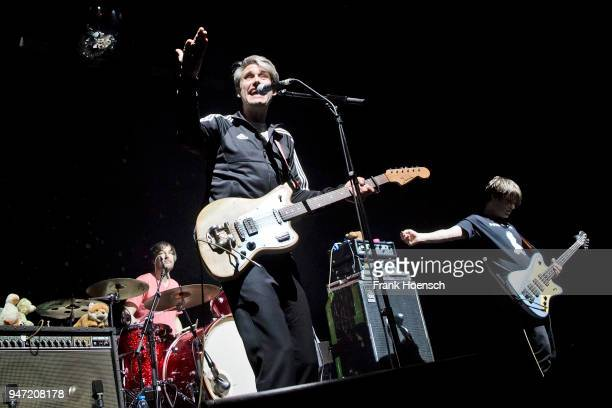 Arne Zank Dirk von Lowtzow and Jan Mueller of the German band Tocotronic perform live on stage during a concert at the Columbiahalle on April 16 2018...