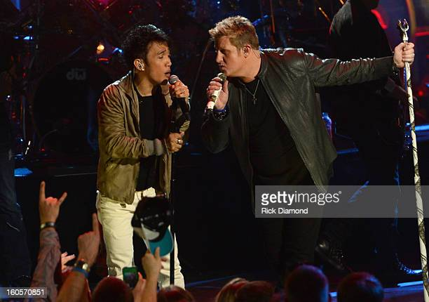 Arnel Pineda and Gary LeVox perform onstage as Journey and Rascal Flatts headline the Super Bowl XLVII CMT Crossroads Concert on February 2 2013 in...