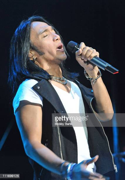 Arnel Pineda lead singer of Journey performs at the Nassau Veterans Memorial Coliseum on August 31 2009 in Uniondale New York