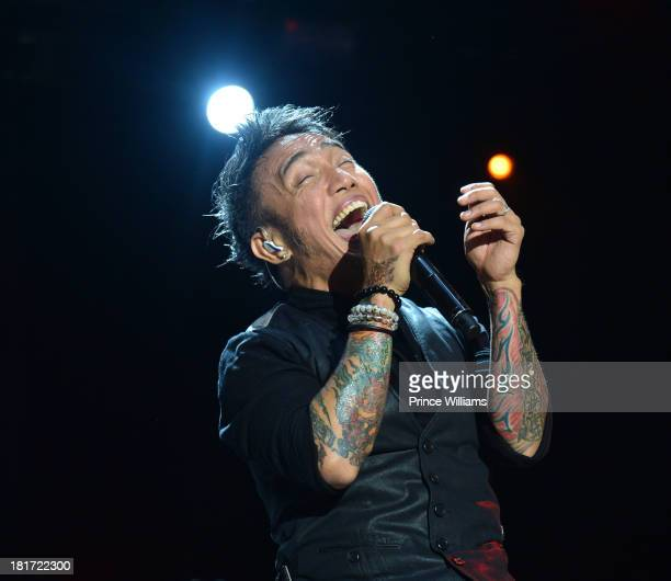 Arnel Pineda of Journey performs during Music Midtown 2013 Day 1 at Piedmont Park on September 20 2013 in Atlanta Georgia