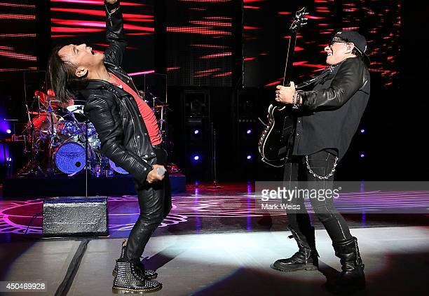 Arnell Pineda and Neal Schon of Journey performs at PNC Bank Arts Center on June 11 2014 in Holmdel New Jersey