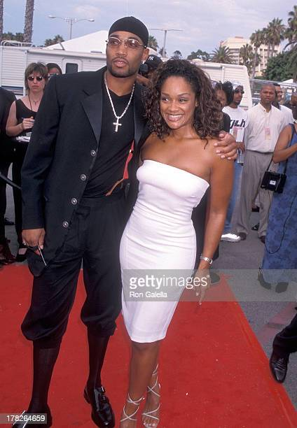 Arnelle Simpson and date Tony Smith attend the Fourth Annual Soul Train Lady of Soul Awards on September 3 1998 at the Santa Monica Civic Auditorium...