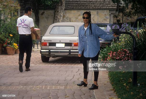 Arnelle Simpson daughter of OJ Simpson buzzes a delivery in at the Rockingham Estate in June 1994 in Brentwood California