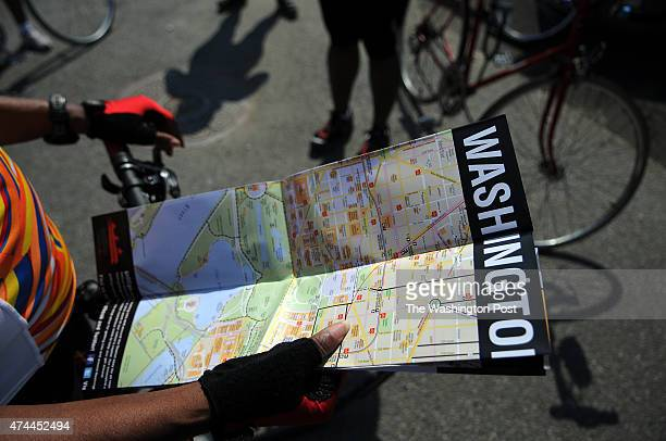 C JUNE 25 2011 Arnetta Davis who is a native Washingtonian studies the newly released DC bike trail map while meeting with fellow members of Black...