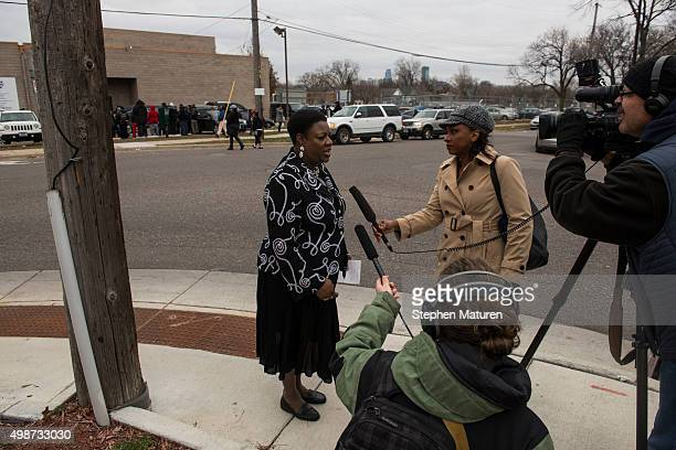 Arnetta Phillips Director of Community Outreach Services at Shiloh Temple speaks with media members outside the funeral service of Jamar Clark at...