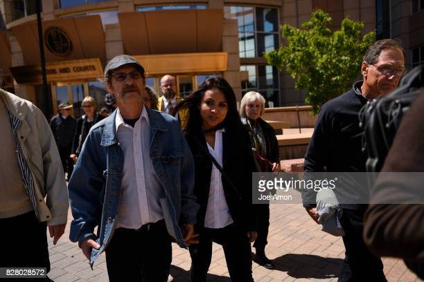 Arnie Carter a member of the New Sanctuary Committee at the First Unitarian Society of Denver and a group of supporters walk with Ingrid Encalada...