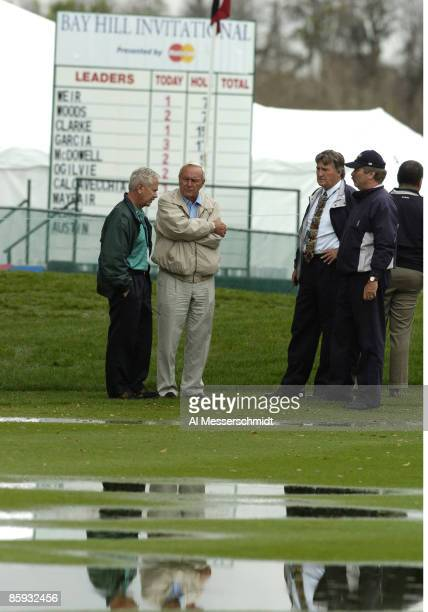 Arnie Palmer inspects water on the ninth fairway after heavy rain delayed play during the first round of the Bay Hill Invitational March 17 2005 in...