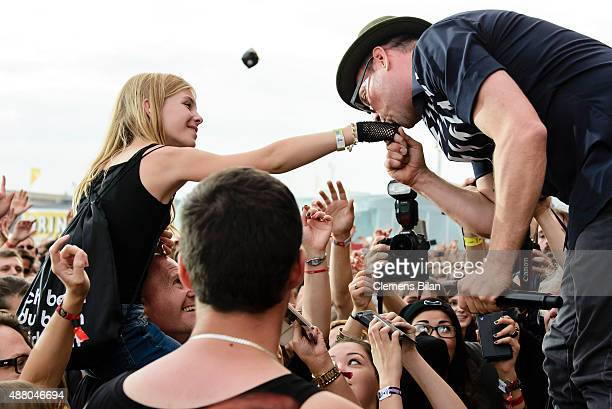 Arnim Teutoburg-Weiss, singer of the band Beatsteaks, gives a female fan a kiss on the hand during the second day of the Lollapalooza Berlin music...
