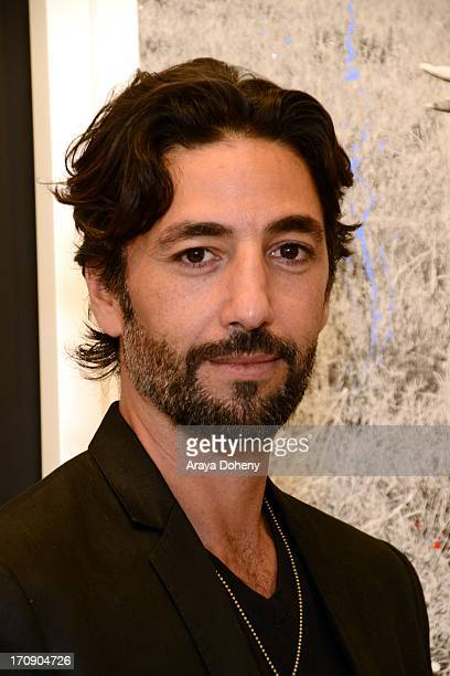 Arno Elias attends a gallery exhibit of Terry O'Neill Presents The Opus A 50 Year Retrospective at Mouche Gallery on June 19 2013 in Beverly Hills...