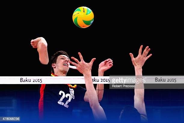 Arno van de Velde of Belgium spikes the ball against Germany in the Volleyball Men Preliminary Pool B during day ten of the Baku 2015 European Games...