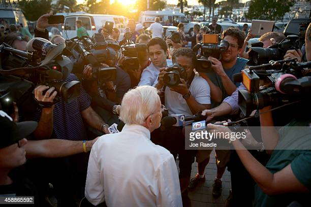 Arnold Abbott a 90yearold chef is surrounded by media as he prepares to feed the homeless in violation of a recently passed city law on November 12...