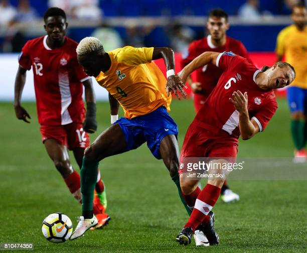 Arnold Abelinti of French Guiana fights for the ball with Samuel Piette of Canada during their Concacaf Gold Cup match at Red Bull Arena on July 7...