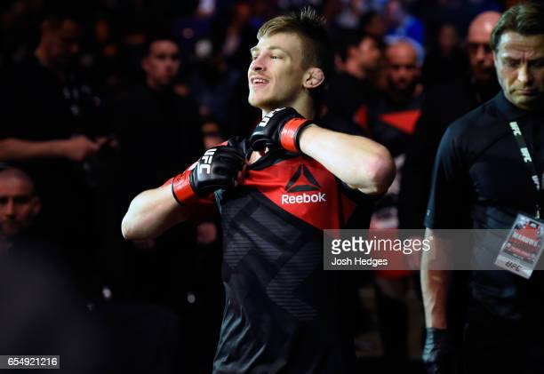 Arnold Allen of England prepares to enter the Octagon before facing Makwan Amirkhani of Finland in their featherweight fight during the UFC Fight...