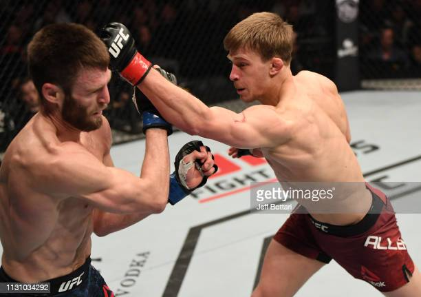 Arnold Allen of England punches Jordan Rinaldi in their featherweight bout during the UFC Fight Night event at The O2 Arena on March 16 2019 in...
