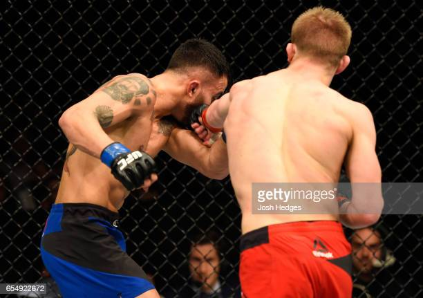 Arnold Allen of England punches Makwan Amirkhani of Finland in their featherweight fight during the UFC Fight Night event at The O2 arena on March 18...