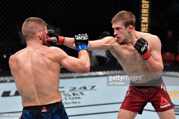 Arnold Allen of England punches Nik Lentz in their featherweight bout during the UFC Fight Night event at PNC Arena on January 25 2020 in Raleigh...