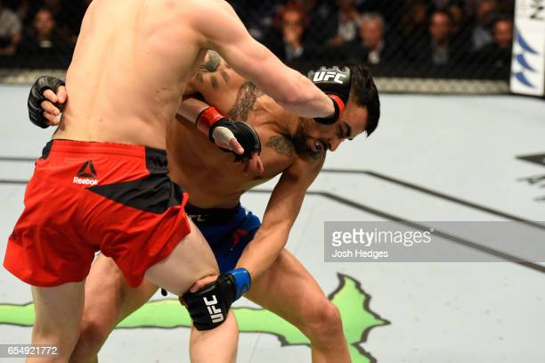 Arnold Allen of England pushes Makwan Amirkhani of Finland in their featherweight fight during the UFC Fight Night event at The O2 arena on March 18...