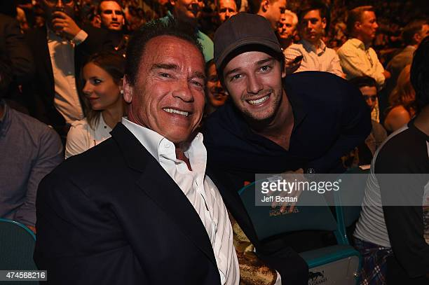 Arnold and Patrick Schwarzenegger in attendance during the UFC 187 event at the MGM Grand Garden Arena on May 23, 2015 in Las Vegas, Nevada.